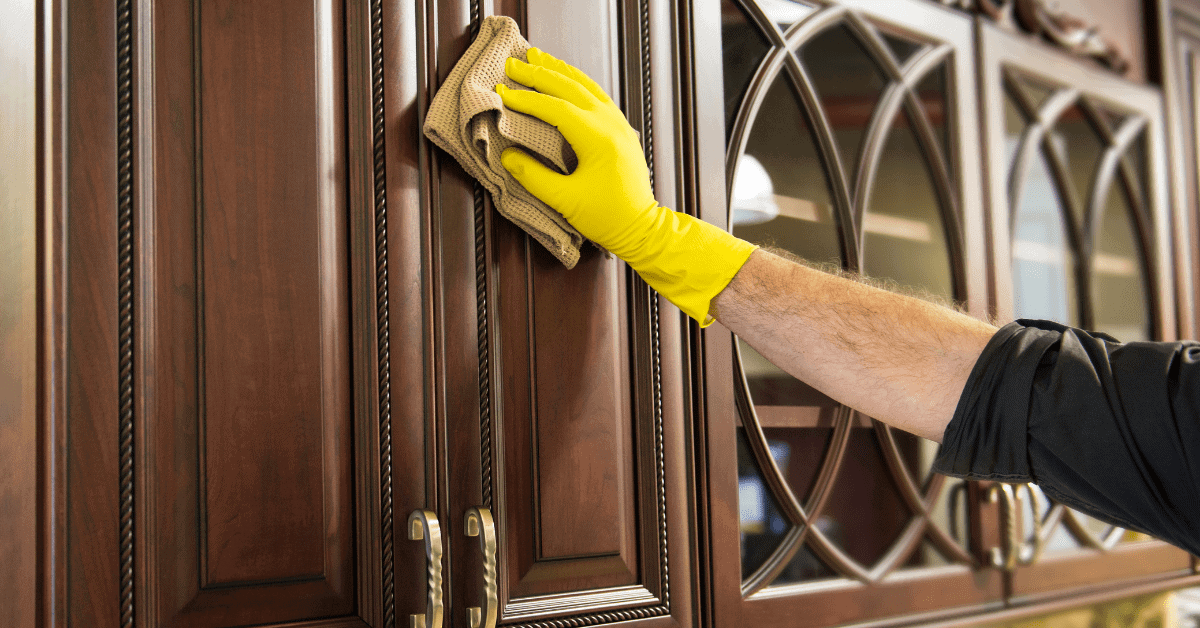 Cleaning wooden kitchen cabinet