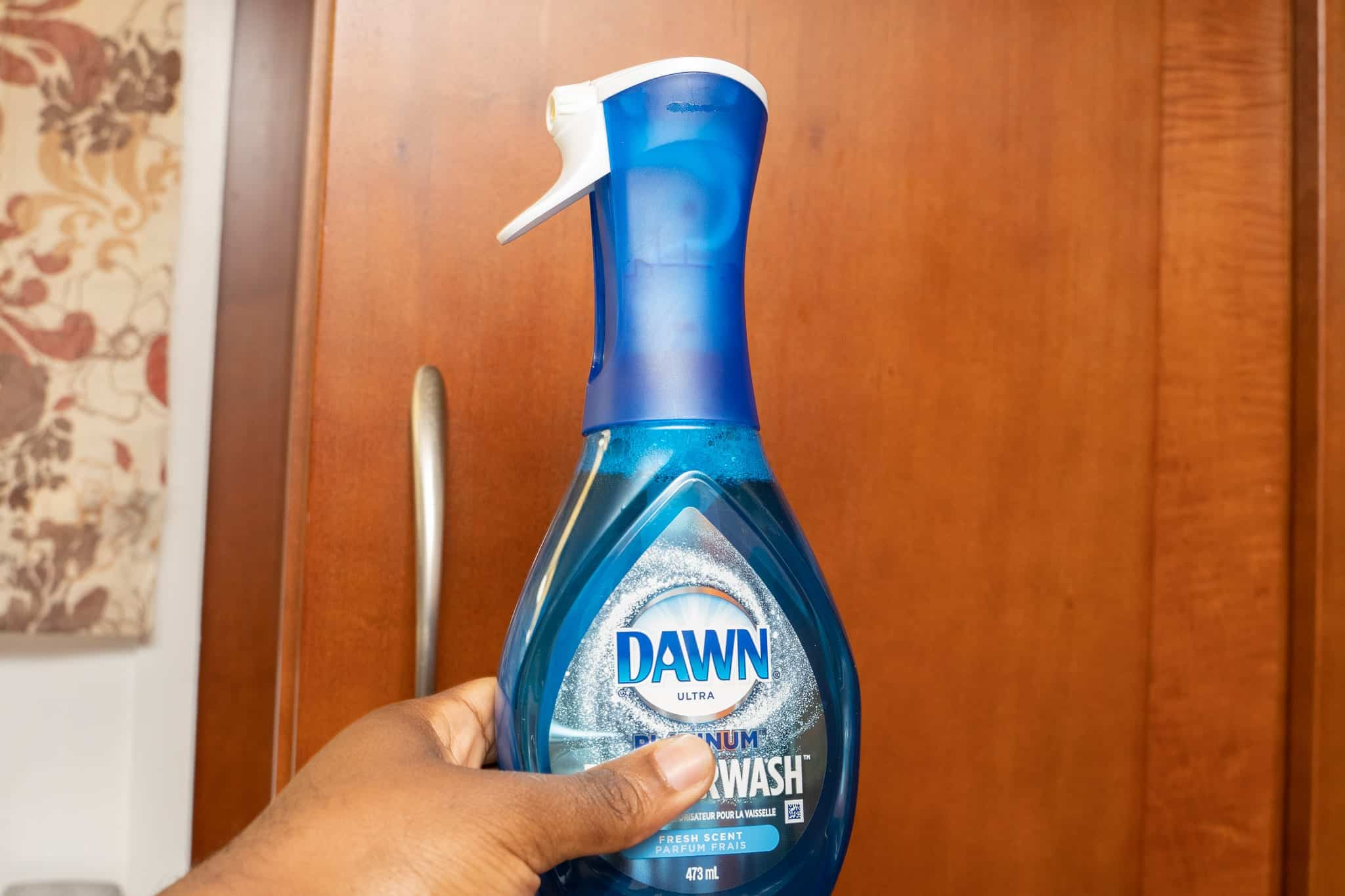 dawn dish soap on wooden cabinets