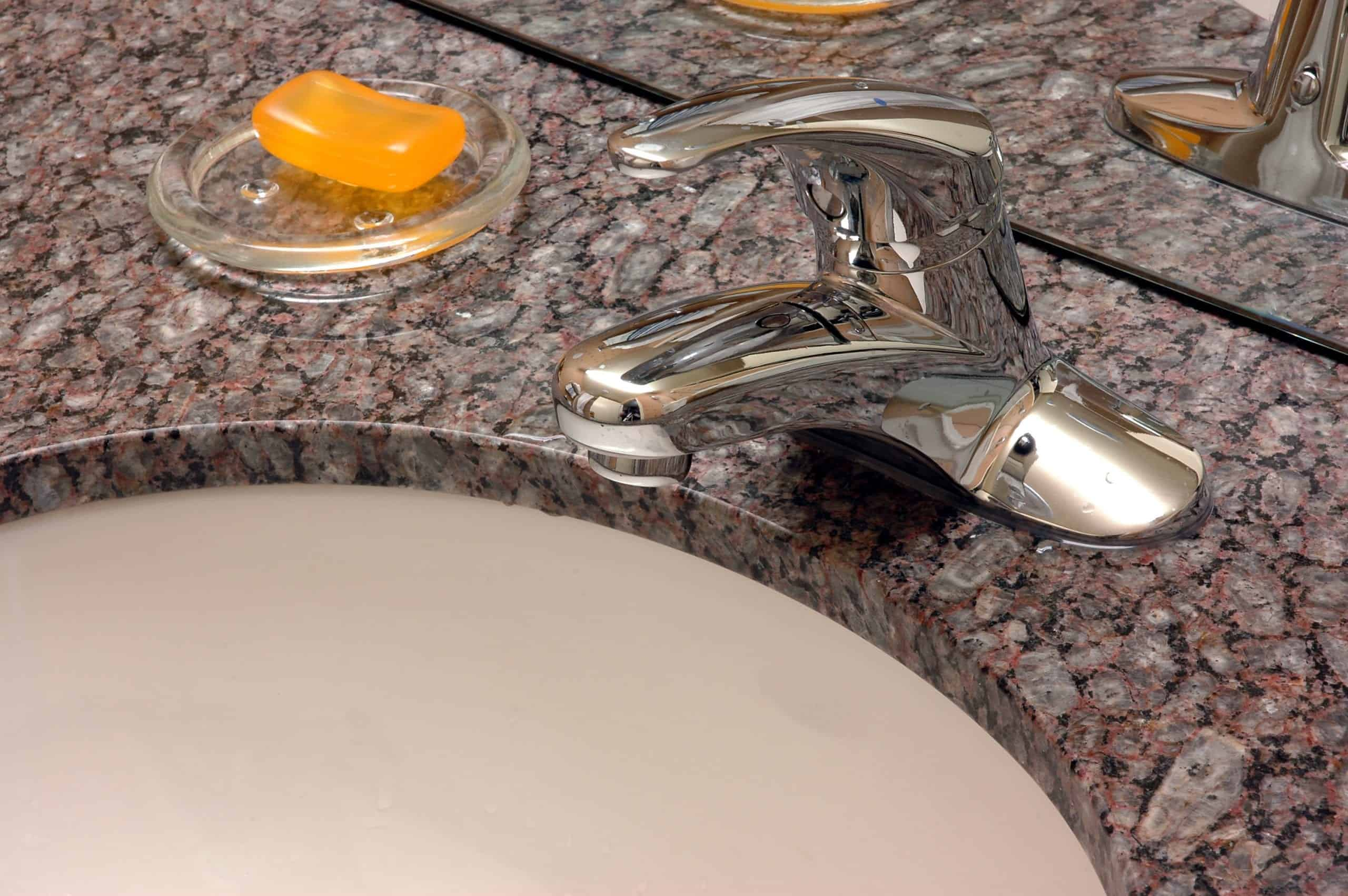 granite countertop and corian bathroom sink